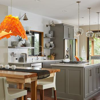 Fiddlehead Design Group - kitchens - orange pendant light, modern orange pendant light, orange pendant light, wooden trestle table, contemporary trestle dining table, trestle dining table, black and white striped rug, striped area rug, white dining chair with wood legs, gray kitchen island, gray shaker cabinets, contemporary gray kitchen, brushed nickel hardware, stove top in island, kitchen island stove top, glass and nickel pendant light, glass sphere pendant light, stainless steel built in fridge, pullout spray head faucet, gray floating shelves, floating kitchen shelves, adjustable nickel wall lamps, adjustable nickel wall sconces, ceiling height subway tile, white subway tile, gray kitchen, dining table off kitchen, island cooktop, island stove, kitchen island stove, gray floating kitchen shelves, eat in kitchen, pub height table,