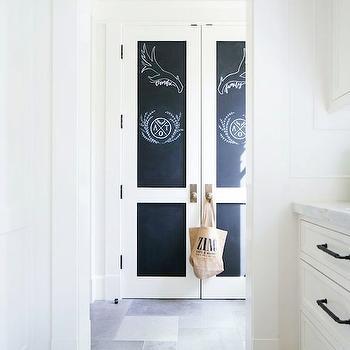 Kelly Nutt Design - laundry/mud rooms - mudroom, mudroom closets, closet doors, chalkboard doors, chalkboard closet doors, slate floor, slate tiled floor, chalkboard paneled doors, closet door ideas,