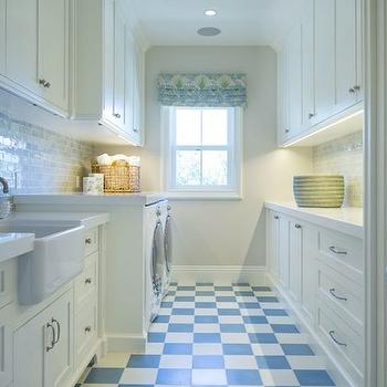 Kelly Nutt Design - laundry/mud rooms - white and blue laundry rooms, long laundry rooms, narrow laundry rooms, checkered floors, checkered tiles, blue checkered tiles, blue checkered floors, checkered laundry room floors, white and blue checkered tiles, shaker cabinets, laundry room cabinets, glazed blue tiles, blue glazed tiles, blue tiled backsplash, farmhouse sink, laundry room sink, blue laundry room backsplash, laundry room farmhouse sink, front load washer dryer,