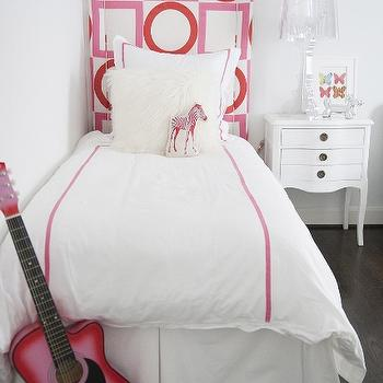 Sally Wheat Interiors - girl's rooms - kids bedrooms, girls bedrooms, white and pink girls rooms, white and pink girls bedrooms, geometric headboard, kids geometric headboard, kids bedding, white and pink kids bedding, single nightstand, twin bed, french nightstand, ghost lamp, bourgie lamp, pink guitar, zebra pillow, pink zebra pillow, victoria hagan fabric,