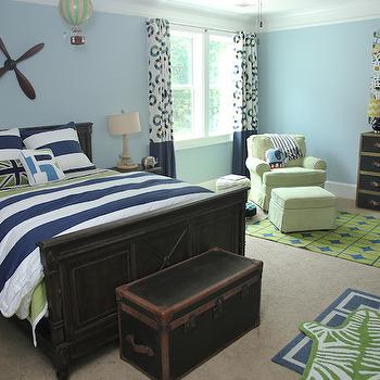 Colordrunk Design - boy's rooms - Benjamin Moore - Yarmouth Blue - blue walls, light blue walls blue and green kids room, blue and green boys room, blue and green boys bedroom, distressed wood bed, distressed wooden bed, distressed wood nightstands, navy rugby striped bedding, navy rugby striped duvet, green bedding, green and blue bedding, rugby stripe duvet, zebra kids rug, green zebra rug, zebra shaped rug, layered rugs, blue and white geometric rug, steamer trunk, steamer style trunk, trunk storage, kids storage trunk, steamer dresser, lime green and blue rug, blue and green geometric rug, multi colored kids art, multi colored abstract art, propeller wall decor, wooden propeller, art over kids bed, art over kids headboard, hot air balloon decor, kids hot air balloon, green armchair, kids room seating, green chair and ottoman, geometric blue drapes, circle print drapes, boys room drapes, distressed kids beds, rugby stripe duvet, navy rugby stripe duvet, striped kids bedding, kids curtains, banded curtains, kids banded curtains, navy banded curtains,