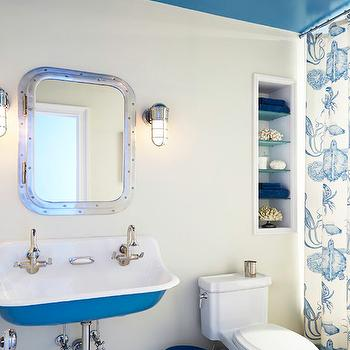 Rob Stuart Interiors - bathrooms - kids bathrooms, boys bathrooms, nautical kids bathrooms, nautical boys bathrooms, shared kids bathrooms, shared boys bathrooms, shared sink, shared kids sink, trough sink, blue trough sink, his and her faucets, gooseneck faucets, rivet mirror, rivet medicine cabinet, riveted mirror, riveted medicine cabinet, marine sconces, nautical sconces, kids bathroom ideas, boys bathroom ideas, blue bathroom sink, blue chevron wastebasket, peacock blue wastebasket, bathroom niche, sea life shower curtain, kids shower curtains, boys shower curtains, vintage penny tiles, blue ceiling, blue bathroom ceiling, painted kids bathroom ceiling,