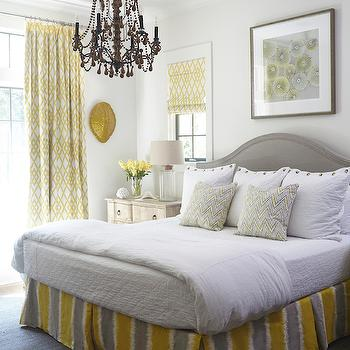 Tracery Interiors - bedrooms - yellow and gray rooms, yellow and gray bedrooms, art over bed, art over headboard, over the headboard art, gray headboard, gray arched headboard, yellow and gray bedskirt, yellow and gray pleated bedskirt, yellow and gray pleated bedskirt, yellow and gray striped bedskirt, zigzag pillows, distressed nightstands, 3 drawer nightstands, glass bottle lamps, nightstand under window, yellow roman shades, lattice roman shades, white and yellow roman shades, yellow lattice roman shade, yellow curtains, yellow lattice curtains, yellow lattice drapes, turtle shell, decorative turtle shell, gold turtle shell, wall turtle shell, wall mounted turtle shell, gray rug, gray jute rug, beaded chandelier, bedroom chandelier, chandelier over bed, cork lamps, cork table lamps, cork top lamp, fillable lamps, fillable table lamps, keepsake lamps,