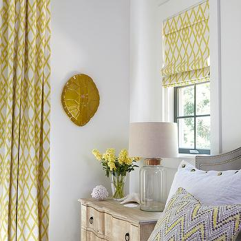 Tracery Interiors - bedrooms - yellow rooms, yellow bedrooms, gray headboard, gray arched headboard, zigzag pillows, distressed nightstands, 3 drawer nightstands, glass bottle lamp, nightstand under window, yellow roman shades, lattice roman shades, white and yellow roman shades, yellow lattice roman shade, yellow curtains, yellow lattice curtains, yellow lattice drapes, turtle shell, decorative turtle shell, gold turtle shell, wall turtle shell, wall mounted turtle shell, gray nailhead headboard, cork lamps, cork table lamps, cork top lamp, fillable lamps, fillable table lamps keepsake lamps,