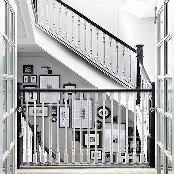 Rob Stuart Interiors - entrances/foyers - black and white staircase, black and white stairwell, white spindles, black banister, black staircase banister, staircase photo wall, stairwell photo wall, black and white photo wall, staircase gallery,