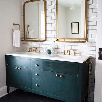 bathrooms: black washstand, black footed vanity, black footed sink vanity, black double vanity, double vanity ideas, black dual sink vanity, black footed dual washstand, footed dual washstand, white quartz, white quartz countertop, accent wall, bathroom accent wall, accent wall in bathrooms, tiled accent wall, tiled bathroom accent wall, white subway tiles, brass vanity mirror, mirror with shelf, brass mirror with shelf, vanity mirror with shelf, brass vanity mirror with shelf, arched vanity mirror, arched brass mirror, arched brass vanity mirror, bronze and glass sconces, gold faucets, his and her sinks, black hex tiles, black hex floor tiles, white mosaic flower tiles, mirror with shelf, vanity mirror with shelf, gold mirror with shelf,