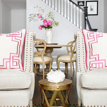Rob Stuart Interiors - living rooms: light gray chairs, gray accent chairs, pillows with greek key trim, greek key pillows, white and pink pillows, pink greek key pillows, brass accent table, antique brass accent table, ikat rug, gold and turquoise rug, gold and turquoise ikat rug, nailhead chairs, linen nailhead chairs,
