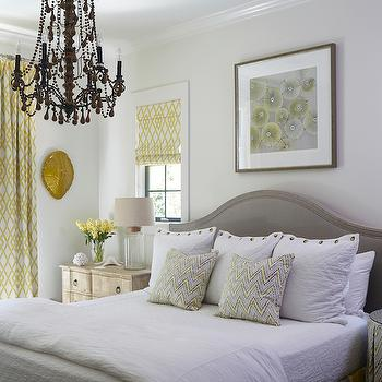 Tracery Interiors - bedrooms - yellow and gray rooms, yellow and gray bedrooms, art over bed, art over headboard, over the headboard art, gray headboard, gray arched headboard, yellow and gray bedskirt, yellow and gray pleated bedskirt, yellow and gray pleated bedskirt, yellow and gray striped bedskirt, zigzag pillows, distressed nightstands, 3 drawer nightstands, glass bottle lamps, nightstand under window, yellow roman shades, lattice roman shades, white and yellow roman shades, yellow lattice roman shade, yellow curtains, yellow lattice curtains, yellow lattice drapes, turtle shell, decorative turtle shell, gold turtle shell, wall turtle shell, wall mounted turtle shell, beaded chandelier, bedroom chandelier, chandelier over bed, mismatched nightstands, mismatched bedside tables, skirted bedside table, cork lamps, cork table lamps, cork top lamp, fillable lamps, fillable table lamps, keepsake lamps,