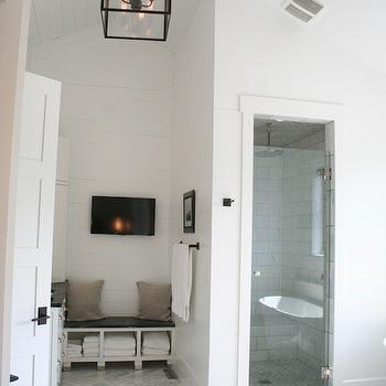 Enjoy Company - bathrooms - glass shower door, shower room, enclosed walk in shower, marble herringbone floors, herringbone floor tile, marble herringbone tiled floors, glass shower door, shiplap, bathroom shiplap, vaulted ceilings, vaulted wood planked ceilings, vaulted bathroom ceilings, ceiling mount shower head, rainfall shower head, iron and glass lantern, iron lantern pendant, contemporary lantern pendant, bathroom tv, television in bathroom, built in bench, built in bathroom bench, bathroom bench with storage, wood planked walls, horizontal wood paneling, walk in shower enclosure, marble brick tile surround, marble tiled shower surround, white and gray bathroom ideas, white marble herringbone tiles, marble herringbone tiles, marble herringbone floor, rain shower head, bathroom lanterns, herringbone shower floor, marble herringbone shower floor,