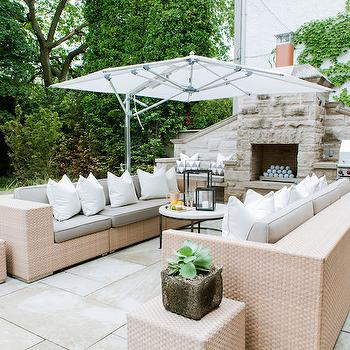 Fleming Distinctive Homes - decks/patios - flagstone patio, contemporary woven outdoor sofa, outdoor seating ideas, outdoor sofa, light woven outdoor sofa, built in outdoor bench, outdoor fireplace, outdoor fireplace ideas, outdoor fireplace with bench, outdoor fireplace with bbq, built in bbq, built in barbeque, iron and stone outdoor table, outdoor coffee table, outdoor living room, iron and stone patio table, cantilever umbrella, cantilever patio umbrella, woven outdoor stool, contemporary outdoor sofa, woven outdoor seating, woven outdoor settee, outdoor sofas, woven outdoor sofas, outdoor bench, built in outdoor bench, outdoor built in bench, integrated bbq,