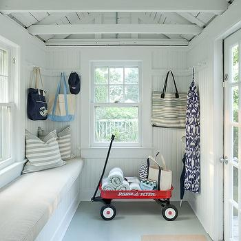 Jenny Wolf Interiors - laundry/mud rooms - cottage mudroom, cottage mudroom ideas, rustic mudrooms, rustic mudroom ideas, truss ceiling, trussed ceiling, truss mudroom ceiling, trussed mudroom ceiling, beadboard walls, mudroom with beadboard walls, mudroom beadboard walls, mudroom bench, long mudroom bench, built in bench, beadboard bench, striped pillows, row of hooks, mudroom hooks,