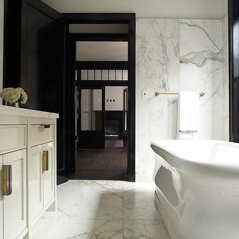 Roman and Williams - bathrooms - gray and white marble tile, marble tile, marble floor tile, marble walls, solid marble wall, marble paneled wall, slab marble wall, marble accent wall, marble bathroom wall, black window, black framed window, black trimmed window, roll top freestanding tub, freestanding bath  freestanding tub, brass tub filler, brass floor mount faucet, brass bathtub faucet, brass towel rail, brass towel rod, ivory bathroom vanity, glossy ivory bathroom vanity, ivory shaker bathroom vanity, brass cabinet pulls, brass hardware, marble bathroom countertop, marble vanity countertop, built in vanity mirror, black door, black interior doors, black moldings, black trim moldings, black window moldings, black bathroom door, black door moldings, roll top bathtub, rolltop bathtub, brass towel holder,