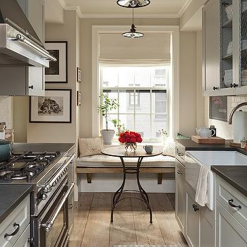 Jenny Wolf Interiors - kitchens - galley kitchens, galley kitchen ideas, country kitchens, country kitchen ideas, galley country kitchens, light gray cabinets, light grey kitchen cabinets, light grey shaker cabinets, chicken wire cabinets, chicken wire kitchen cabinets, chicken wire cabinet doors, farmhouse sink, gooseneck faucet, stainless steel kitchen hood, black stove, black range, wide plank floors, rustic wide plank floors, striped kitchen rug, white and green striped rugs, breakfast nook, eat in kitchens, eat in kitchen ideas, kitchen window seat, kitchen bench, rustic bench, rustic kitchen bench, kitchen window seat, window seat in kitchen, kitchen window seat ideas, bistro table, wood and iron table, wood and iron bistro table, vintage barn lights,