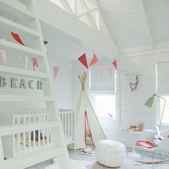 Jenny Wolf Interiors - girl's rooms - white nursery, white nursery ideas, nursery loft, loft playroom, playroom loft, loft play space, loft ladder, nursery loft ideas, white crib, teepee, play teepee, teepee with pom pom fringe, white moroccan pouf, white leather pouf, white moroccan leather pouf, rocker, white rocker, molded plastic rocker, pink zigzag rug, white and pink rug, nursery rug, pink nursery rug, chevron nursery rug, nursery vaulted ceiling, vaulted ceiling nursery, nursery banner, white and pink nursery, white and pink nursery ideas, paneled nursery,