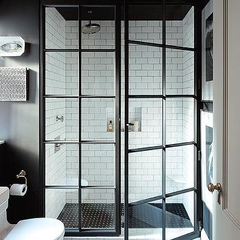 Jenny Wolf Interiors - bathrooms: black and white bathrooms, black and white baths, black and white bathroom ideas, steel shower doors, glass and steel shower doors, subway tiles, shower subway tiles, black shower floor, black shower floor tiles, shower niche, tiled shower niche,