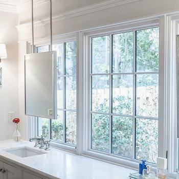 Christopher Architects - bathrooms - hanging mirrors, hanging vanity mirror, mirror in front of window, vanity mirror in front of window, mirror suspended from ceiling, mirror placed in front of windows, custom vanity, honed white marble, honed white marble countertops,