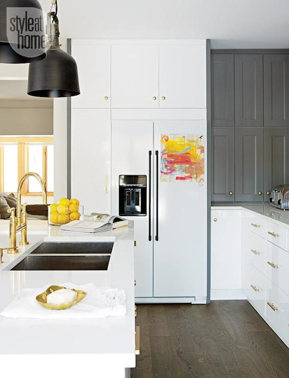 Style at Home - kitchens - dual basin sink, two bowl sink, brass faucet, brass gooseneck faucet, brass bridge faucet, glossy white cabinets, two tone kitchen, gray and white kitchen, modern white cabinets, brass drawer pulls, brass cabinet hardware, kitchen island sink, island with sink, oil rubbed bronze yoke pendant, steel yoke pendant, cabinets around fridge, pantry cabinets, floor to ceiling pantry cabinets, built in pantry cabinets, white fridge, white refrigerator, gray shaker cabinets, ikea cabinets, ikea kitchen cabinets, white ikea cabinets, gray ikea cabinets, white quartz counters, white quartz, ikea cabinets, ikea kitchen cabinets, island dual sink, white and gray cabinets, white and gray kitchen cabinets, brass kitchen hardware, 2 tone kitchen cabinets, pantry next to fridge, pantry cabinets next to fridge,