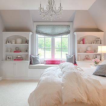 Studio M Interiors - girl's rooms - sloped ceiling, gray walls, gray wall color, pink and gray bedrooms, pink and gray girls bedroom, pink and gray pillow, pink and gray euro sham, silver sequin pillow, silver sequined pillow, built in window bookshelves, window built ins, window seat, built in window seat, window seat built ins, beadboard backed bookshelves, beadboard lined bookshelves, gray seat cushion, hot pink bolster pillow, gray roman shade, beige cart, white console, white duvet, white bedding, white tufted headboard, white button tufted headboard, white crystal chandelier, girls room chandelier, pink and gray kids rooms, pink and gray girls rooms, kids window seat, window seat reading nook, reading nook window seat, kids window seat reading nook, kids reading nook window seat, kids built in bookcase, kids desk, tv over desk, over the desk tv, white lacquered desk,