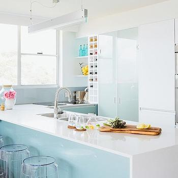 The Home Australia - kitchens - blue kitchen, white and blue kitchen ideas, modern blue and white kitchen, modern white kitchen cabinets, white kitchen cabinets, glass pantry door, modern glass pantry door, recycled glass pantry door, built in wine rack, kitchen wine rack, built in wine cubbies, open shelves, blue backsplash, peninsula island, kitchen peninsula, peninsula sink, peninsula breakfast bar, waterfall edge counter, waterfall edge peninsula counter, stainless steel dual basin sink, modern spray faucet, clear counter stools, acrylic counter stool, backless acrylic counter stool, ghost stool, glossy blue cabinets, blue kitchen cabinets, blue cabinets, modern linear pendant light, u shaped kitchen ideas, stainless steel wall oven, single wall oven, microwave over wall oven, microwave above wall oven, frosted glass pantry doors, bi fold pantry doors, glass bi fold pantry doors, frosted glass bi fold pantry doors, over the counter wine rack, built in wine rack, acrylic backless barstools,