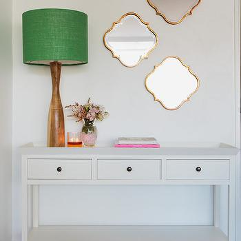 The Home Australia - entrances/foyers: white three drawer console, white console table, white tray console table, tray top console table, wooden lamp, modern wood lamp, wood lamp, green drum shade, green lamp shade, gold arabesque mirror, gold moroccan shaped mirror, gold moorish mirror, entryway ideas, entryway console table, foyer console table, 3 drawer console, tray console table, white tray console table, foyer mirrors, foyer tables, gold quatrefoil mirrors, quatrefoil mirrors,