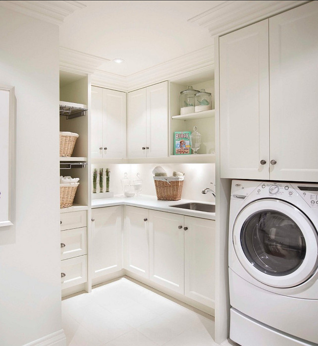 washer dryer below cabinets transitional laundry room