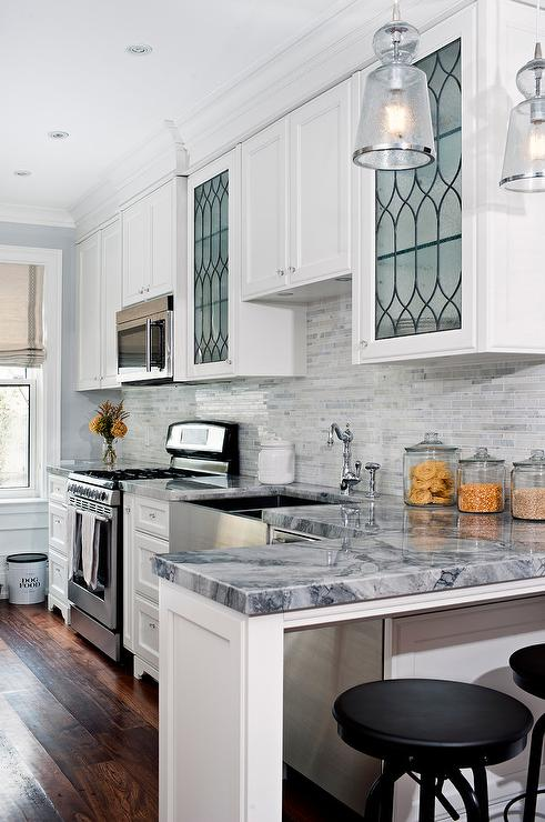 Kitchen with leaded glass cabinets transitional kitchen for Beveled glass kitchen cabinets