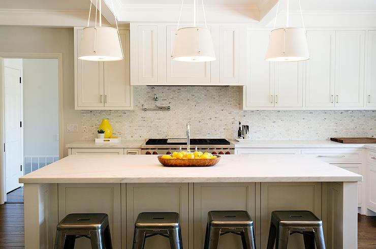 white kitchen with white mosaic marble backsplash transitional
