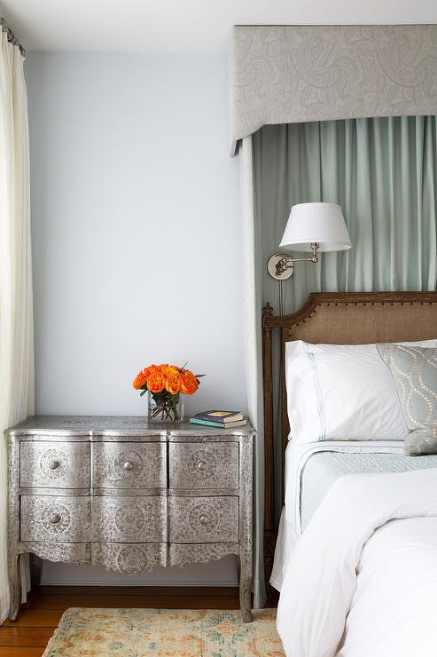 Curtain above bed