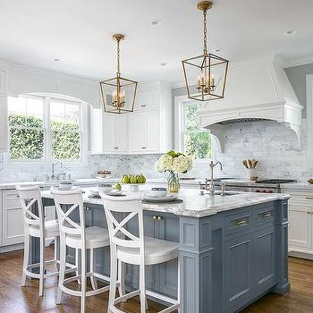 Blue Kitchen Island With White Wood X Back Counter Stools