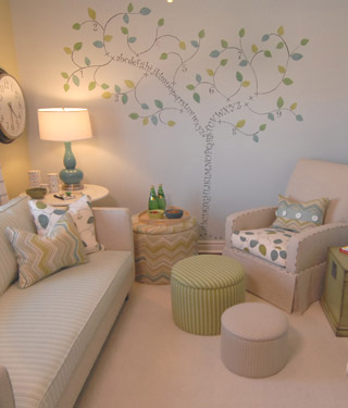 Baby Wall Designs nursery Nursery Tree Wall Stencil Mural White Sofa White Glider Green Striped Ottoman And Green Trunk Table Sarah Richardson Design