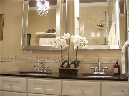 Cream bathroom cabinets  silver beveled bevel mirrors and black granite countertops  Love chandeliers in bathrooms  Cream black bathroom. Beveled Bathroom Mirrors Design Ideas