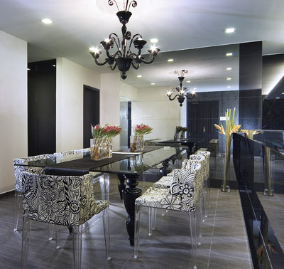 Delightful Modern Eclectic Hollywood Regency Dining Room With Glossy Black Chandelier,  Black Glossy Lacquer Dining Table And Damask Dining Room Chairs With Lucite  ...
