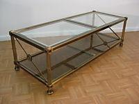 HOLLYWOOD REGENCY BRASS / GLASS TABLE MODERN EAMES ERA, eBay (item 140273453574 end time Oct-13-08 18:07:40 PDT)