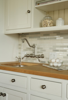 Cream Tile Backsplash Transitional kitchen