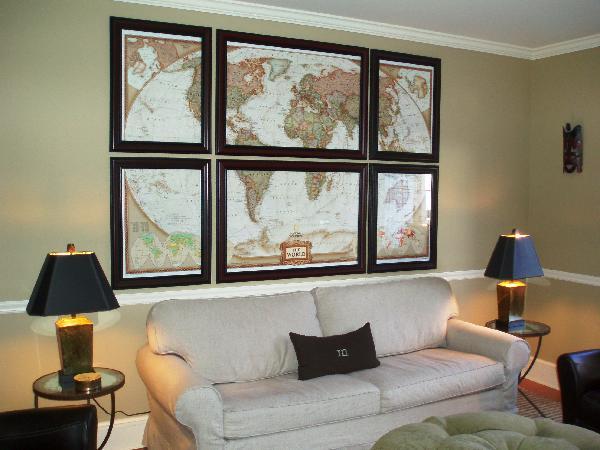 diy world map art slipcovered linen sofa green tufted ottoman chair rail and lamps