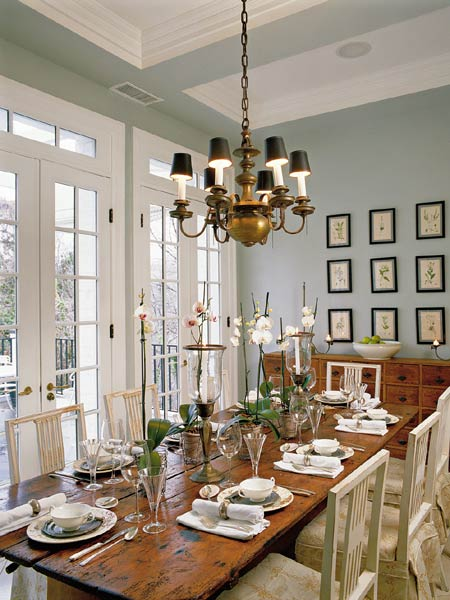 Dining Room Soft Blue Gray Walls Brass Chandelier Rustic Farmhouse Table White Chairs French Doors Buffet And Art