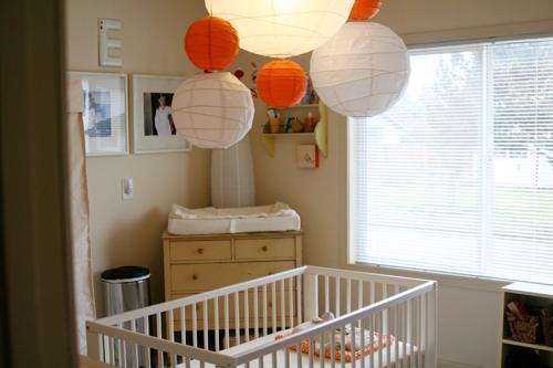 Paper Lanterns White And Orange Paper Lanterns Mobile, White Crib, Changing  Table And Soft Tan Walls.