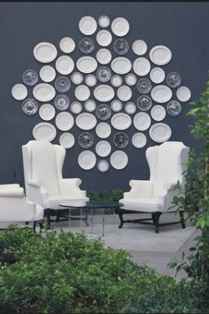 viceroy hotel white wingback chairs blue walls and decorative plates art gallery - Decorative Wall Plates