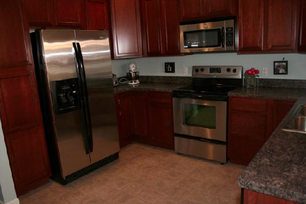 Cherry maple wood kitchen cabinets for What kind of paint to use on kitchen cabinets for metal wall art mirrors