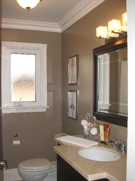 Work in progress   espresso mirror  stone countertops  espresso cabinet and taupe walls paint color. Taupe Bathroom Design Ideas