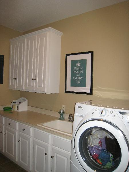 Laundry Room With White Cabinets And Keep Calm Print
