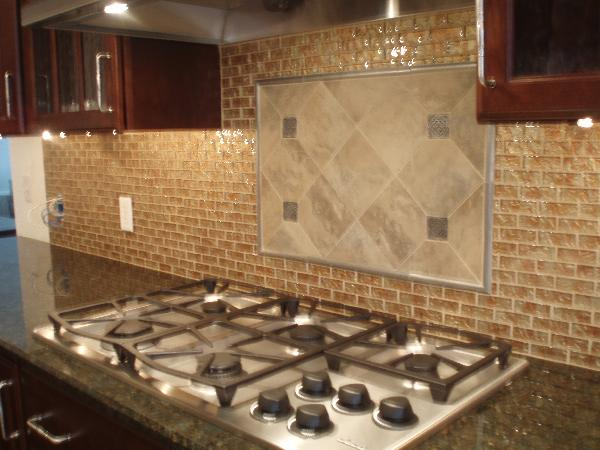 Kitchen glass tiles backsplash, cherry cabinets and granite countertops.