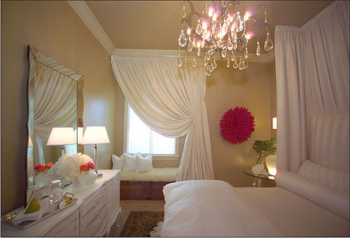 pretty  airy bedroom white drapes  scalloped mirror  white dresser and  window seat. Drapes Behind Bed Design Ideas