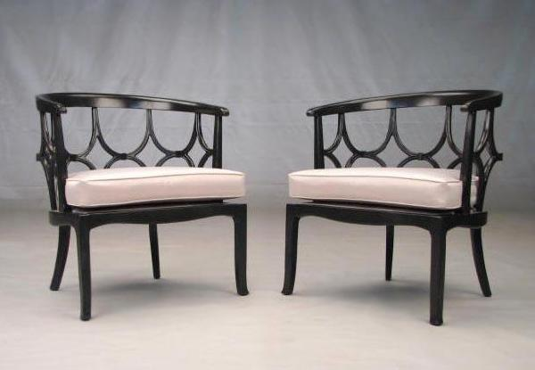 Hollywood Regency Black And Ivory Round Back Lounge Chairs