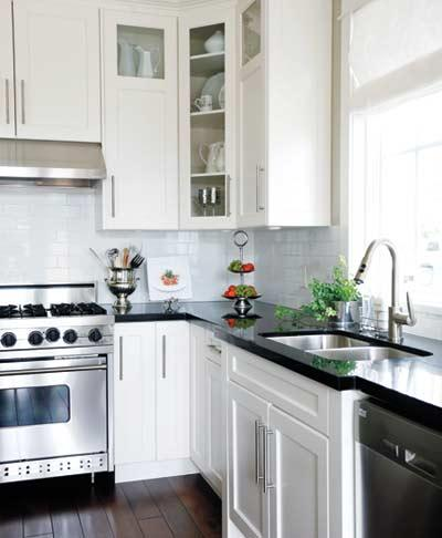Black countertops and white cabinets traditional for Best countertops for white cabinets