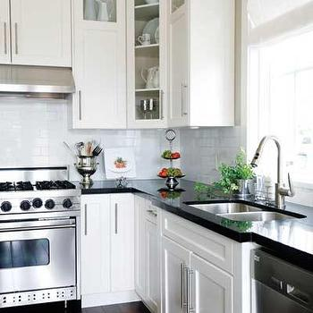 Polished Black Countertops Transitional Kitchen Newman And Wolen Design