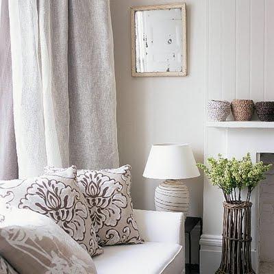 white linen inspired white sofa linen pillows lamp linen drapes beadboard and fireplace linen curtains
