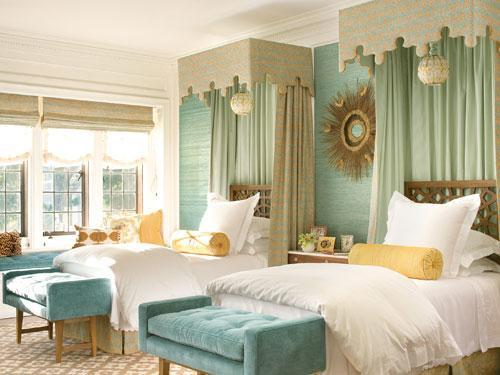 Green blue grasscloth wallpaper twin beds blue tufted velvet benches wood headboards blue green silk drapes and rug