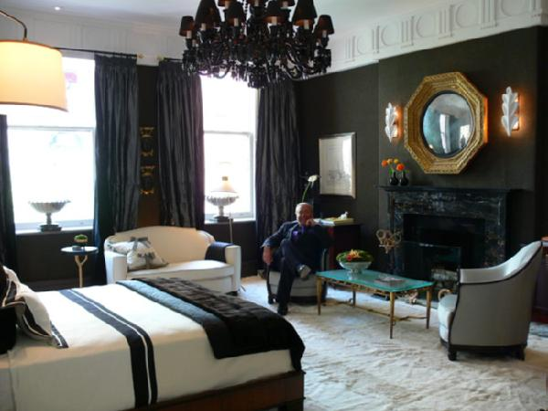 Dramatic Bedroom Black Crystal Chandelier, Brass Octagon Mirror, Black Silk  Drapes, Sconces, Crown Molding, Black Walls, And Black Drapes.