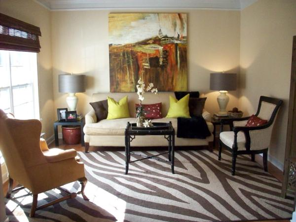 Zebra rug transitional living room emily a clark for Living room ideas with zebra rug